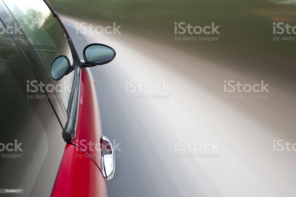 Drive with red sportive car in motion. royalty-free stock photo