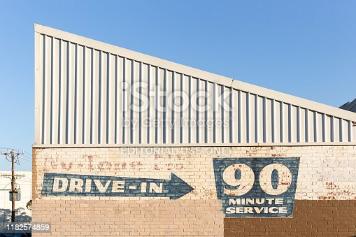 168589045 istock photo Drive-In 90 Minute Service Signage On Vintage Brick Wall During Summer 1182574859