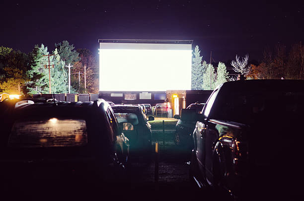 Drive-in Movie Fogged up cars parked at a drive-in movie theatre with blank screen movie theater stock pictures, royalty-free photos & images