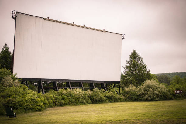 Drive-In Theater movie screen stands in the distance stock photo