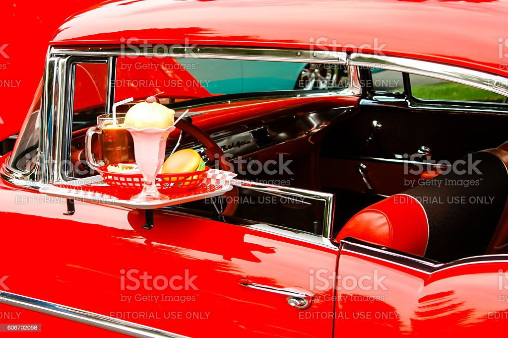 Drive-In window tray on a red 1957 Chevrolet stock photo