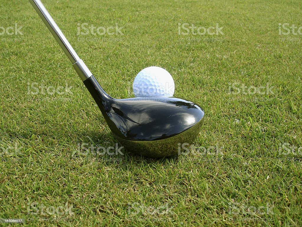 Driver and golf  teed ball royalty-free stock photo