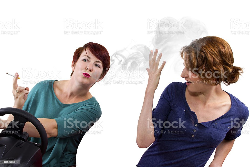 Driver Blowing Second Hand Smoke to the Passenger royalty-free stock photo