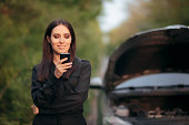 istock Driver Calling Insurance Company after Car Breakdown on the Road 985458624