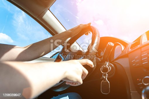 Driver car. Fun drive in summer vacation ride day. Happy young woman have road travel trip inside car in sunny day