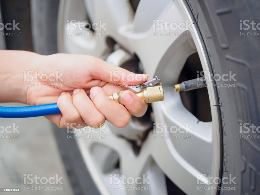 driver checking air pressure stock photo