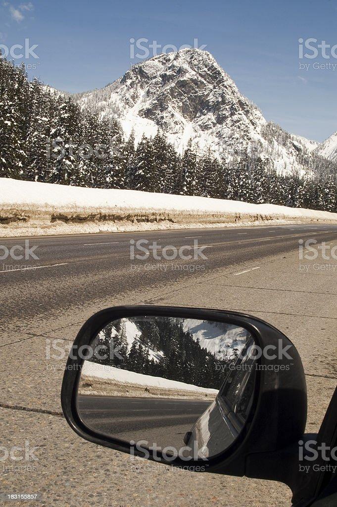 Driver Checks Rear View Mirror Motoring North Cascades Washington stock photo