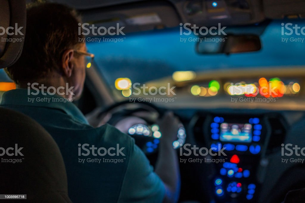Driver concentrating at night stock photo