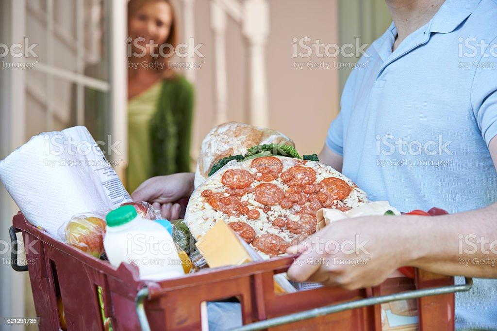 Driver Delivering Online Grocery Order stock photo