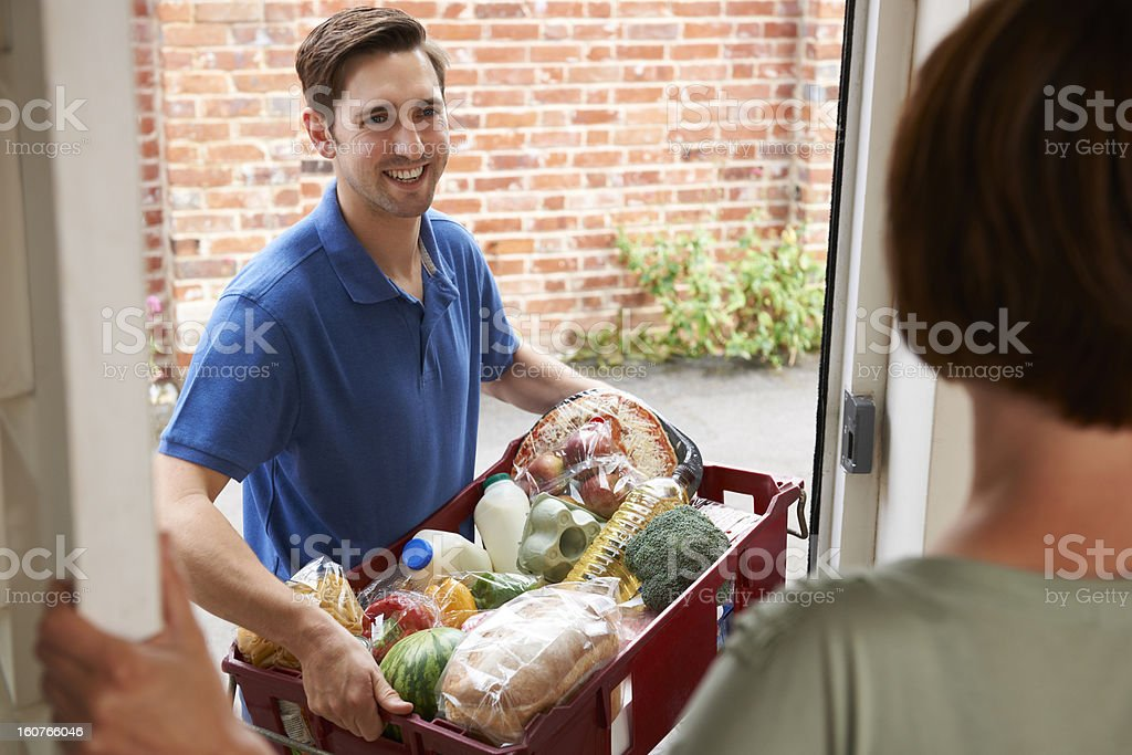 Driver Delivering Online Grocery Shopping Order stock photo