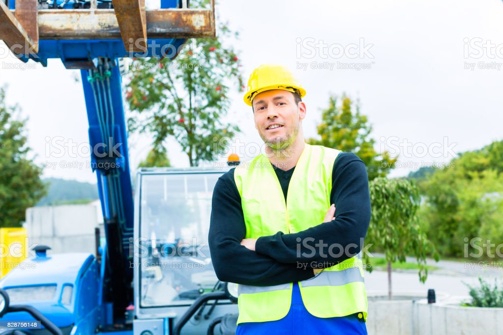 Driver driving  construction excavator stock photo