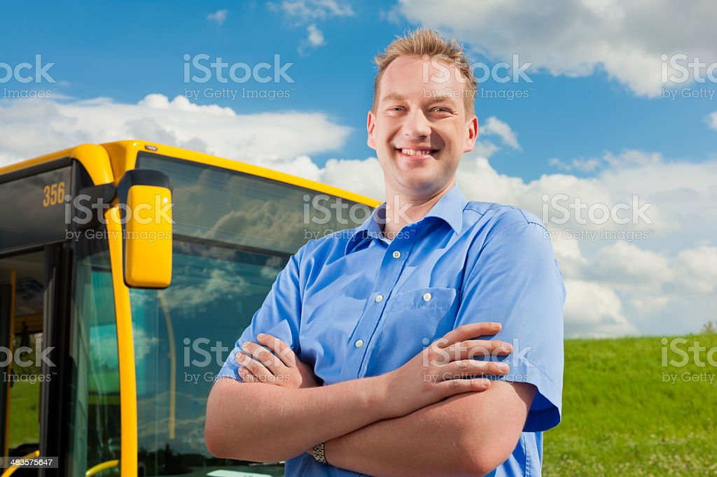 Driver in front of his bus stock photo