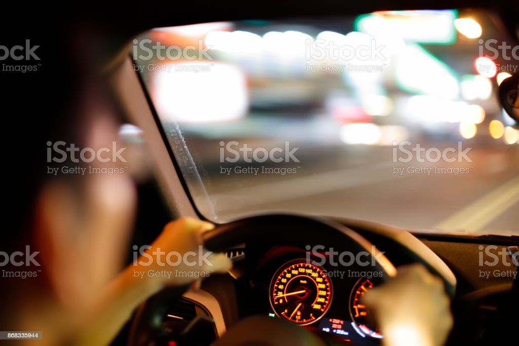 driver in the car at night stock photo