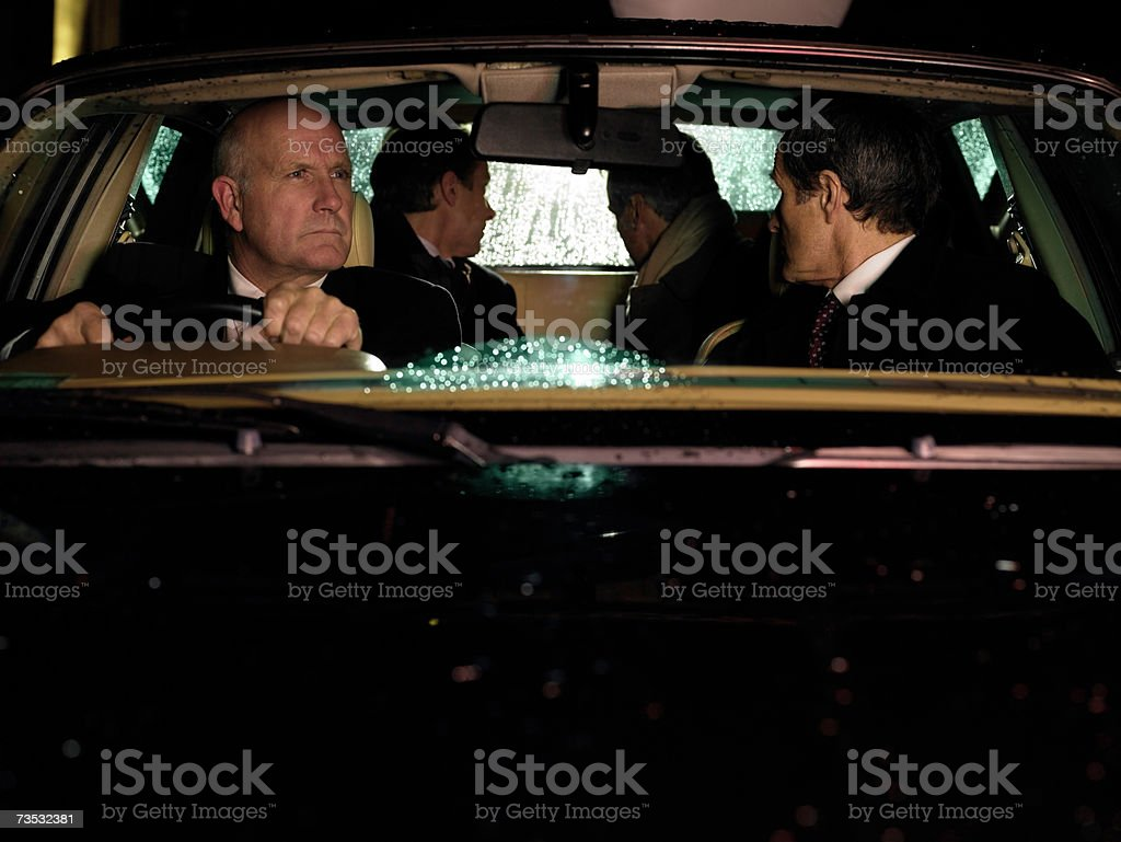 Driver looking in rearview mirror, men looking through rear window royalty-free stock photo
