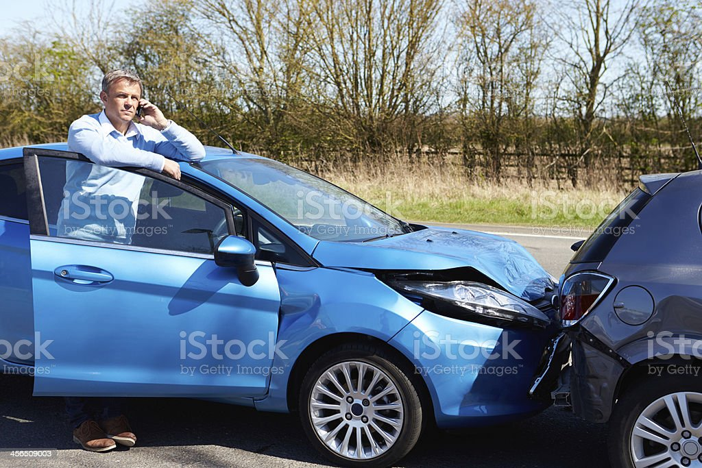 Driver Making Phone Call After Traffic Accident stock photo