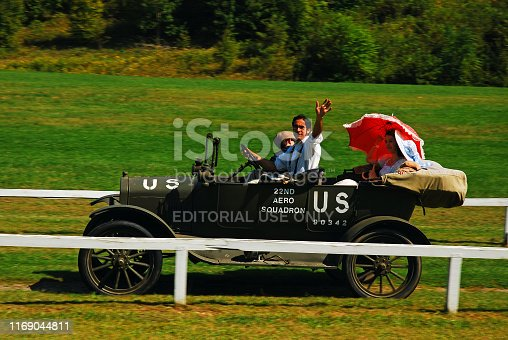 Rhinebeck, NY, USA September 4 A driver of a vintage jeep waves to the crowd at a show in Rhinebeck, New York