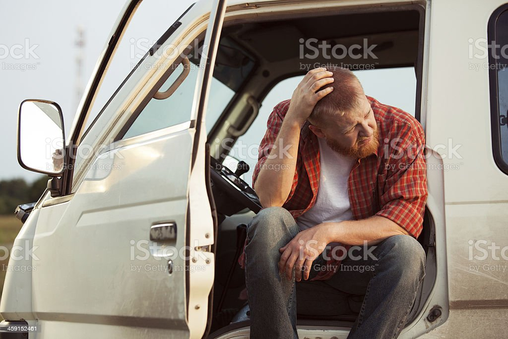 Driver of the car is sitting thinking stock photo