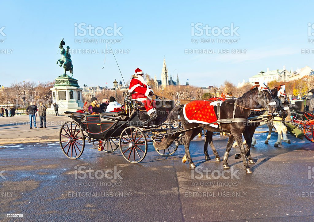 driver of the fiaker is dressed as Santa Claus royalty-free stock photo