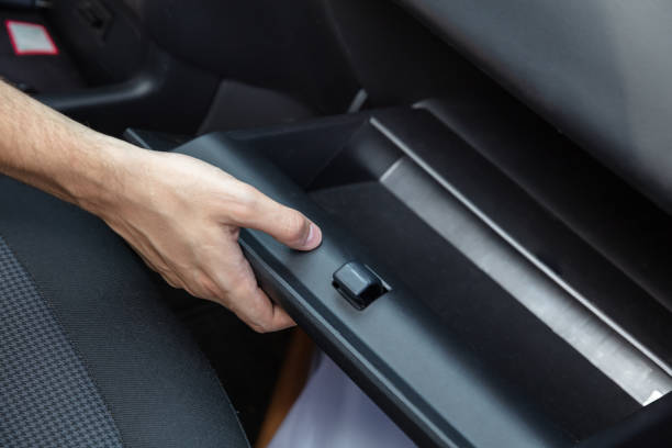 Driver Opening Empty Glovebox Compartment stock photo