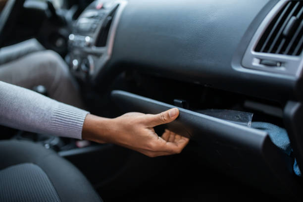 Driver Opening Glovebox Compartment stock photo