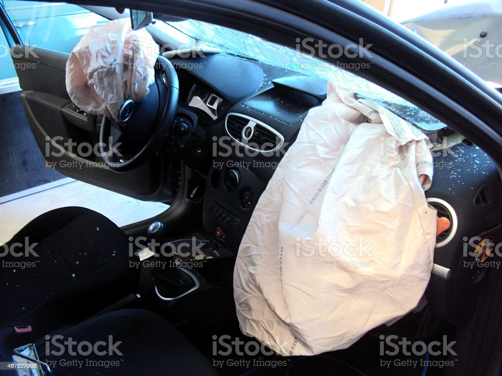 Driver passenger airbags deployed stock photo