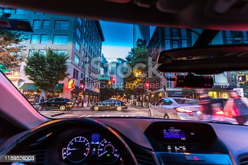 Atlanta, USA - June 16, 2019: Personal view from inside a vehicle of the busy city streets in the downtown district of Atlanta at night.