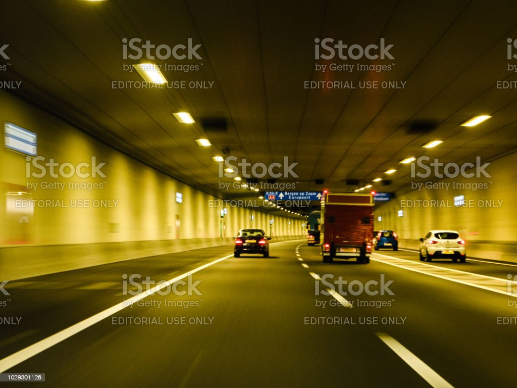 Driver point of view pov in Dutch tunnel highway stock photo