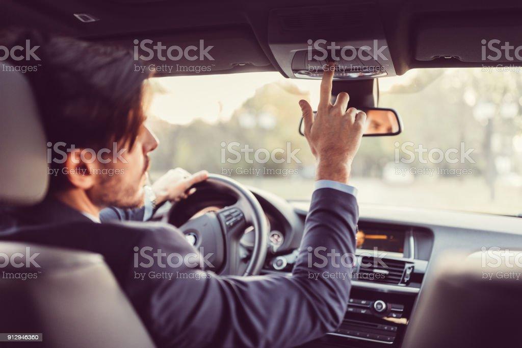 Driver pressing the sos button stock photo
