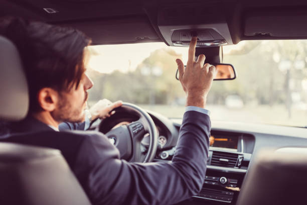 driver pressing the sos button - rideshare stock photos and pictures