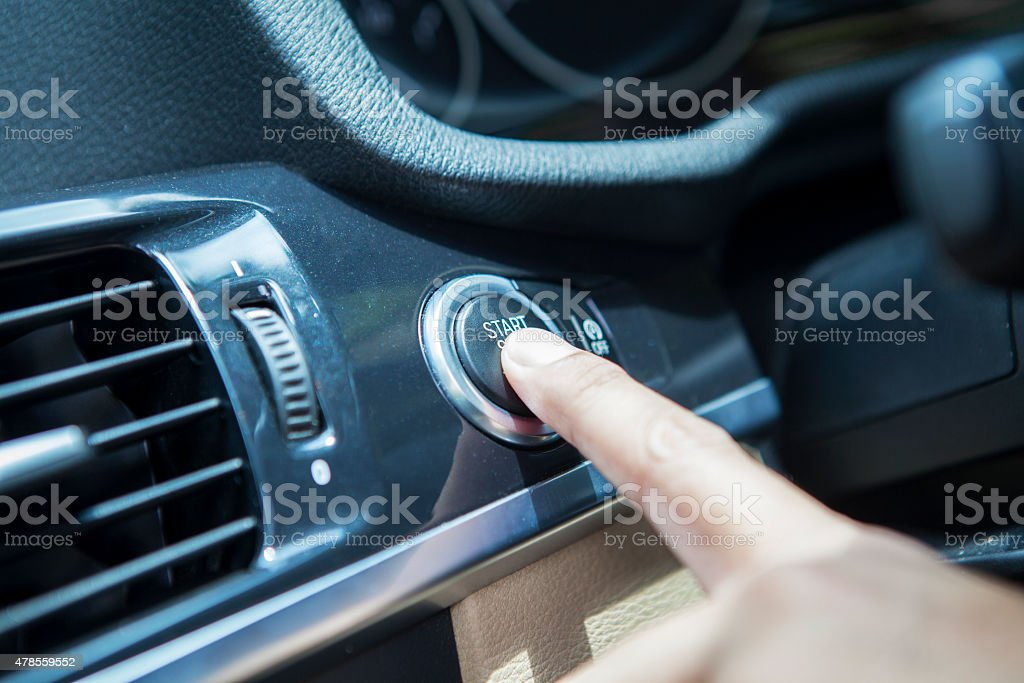 Driver push start button of a car stock photo