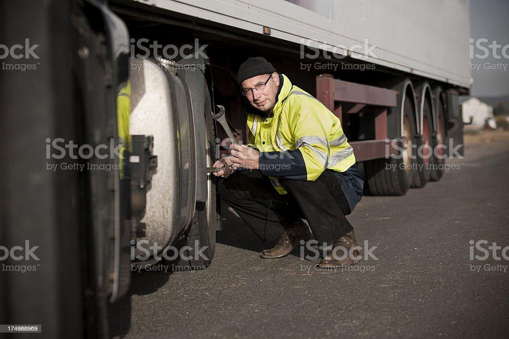 Driver repairing truck stock photo