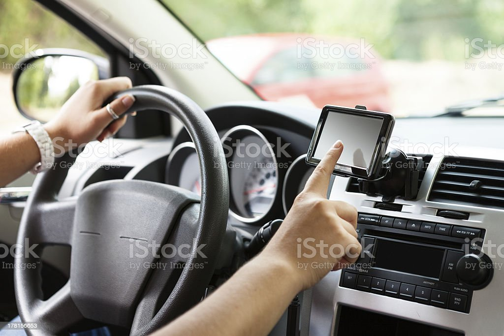 Driver setting navigation system royalty-free stock photo