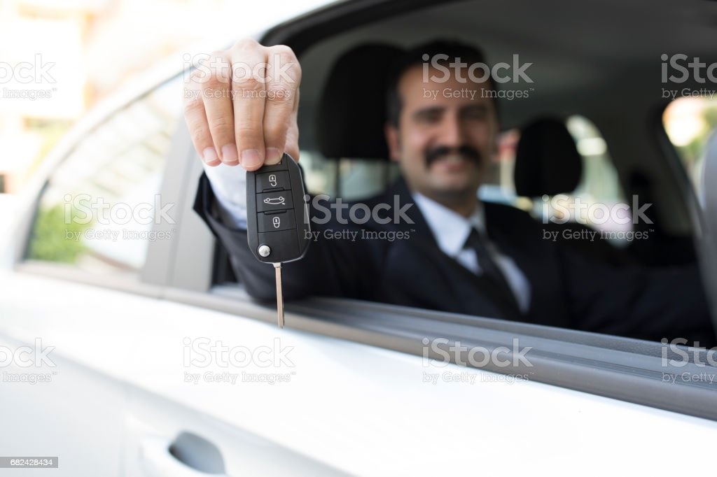 Driver Showing Car Key royalty-free stock photo