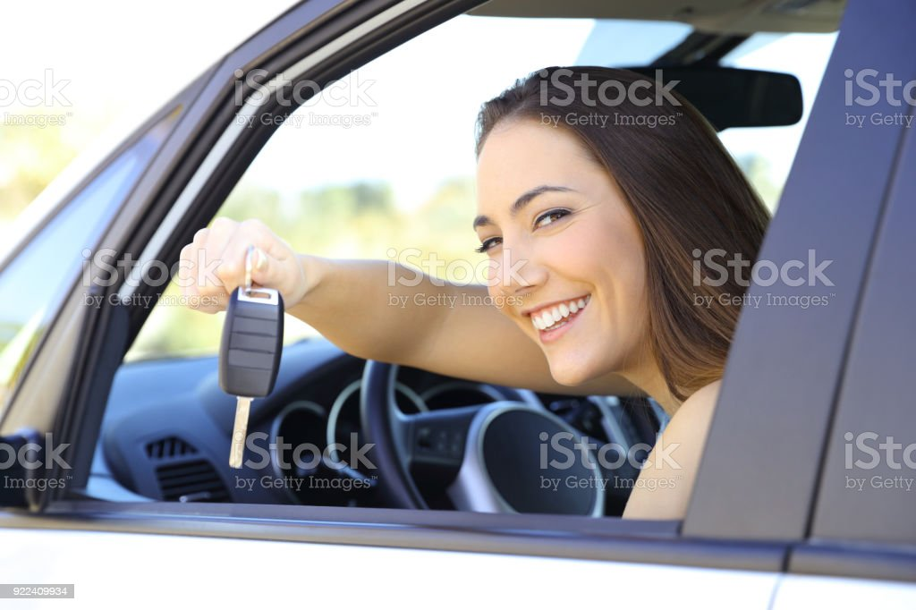 Driver showing the car keys to camera stock photo