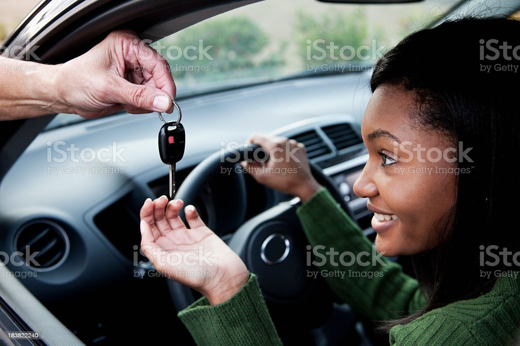 Driver takes the car key stock photo