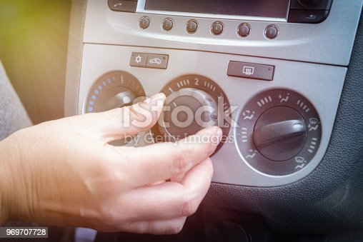 istock Driver using car air-conditioning system 969707728