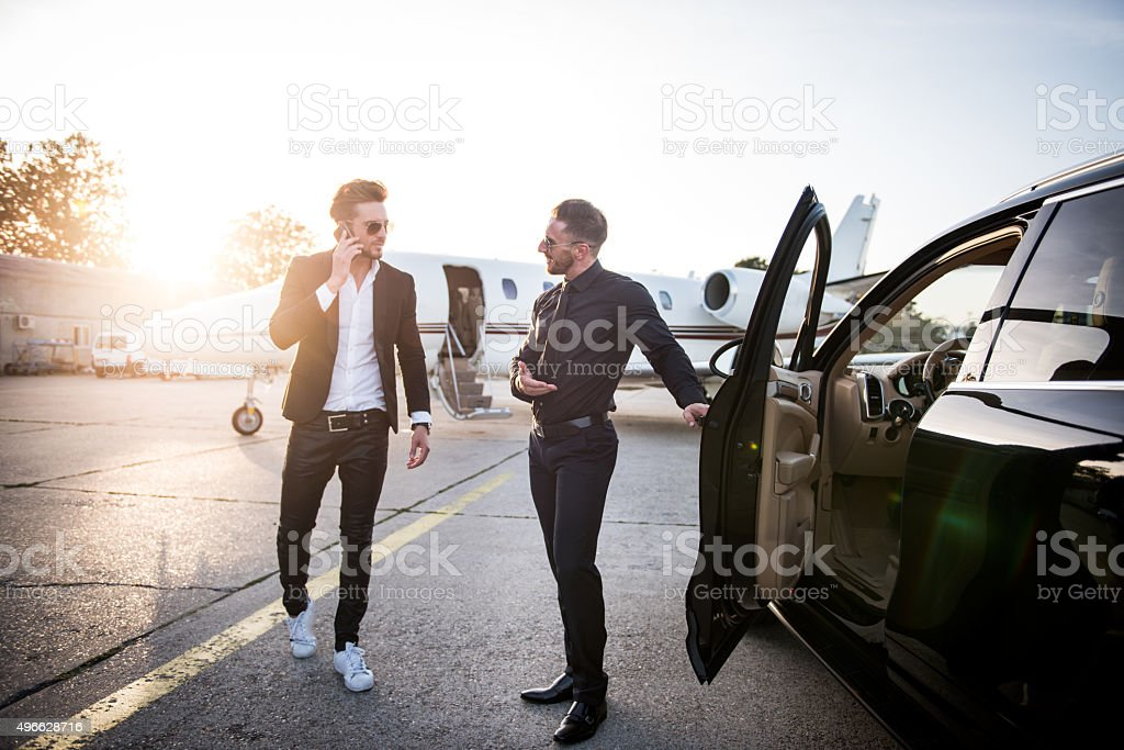 Driver waiting for celebrity at the airport stock photo