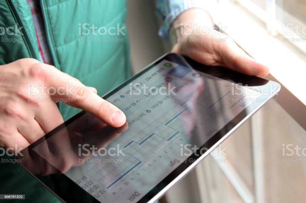 driver writing electronic log books stock photo