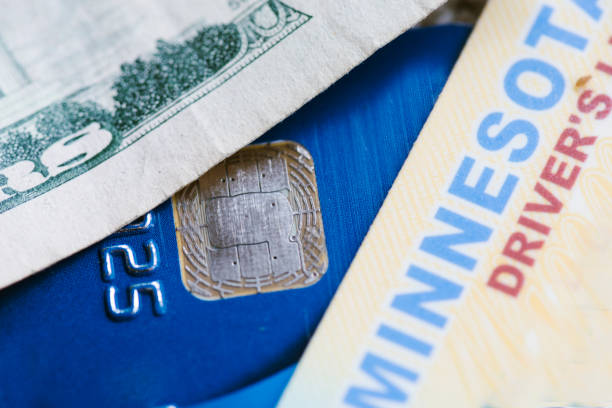 Drivers license, money and credit card close up stock photo