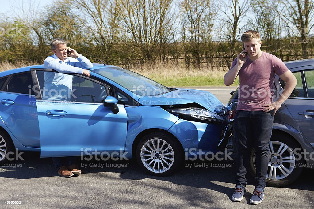 Drivers Making Phone Call After Traffic Accident stock photo