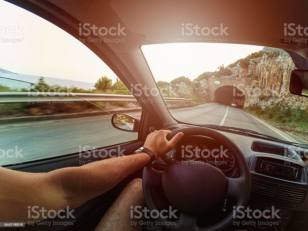 Drivers POV on road and tunnel stock photo