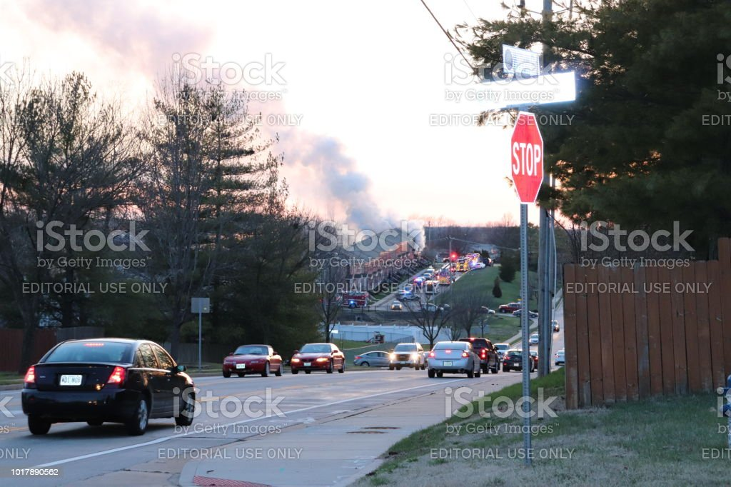 Drivers Slow Down Traffic to Gaze at Condominium Fire stock photo