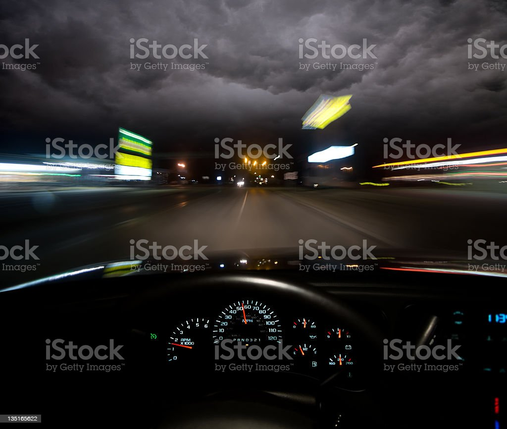 Driver's view of empty road at night stock photo