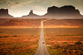 Adult man in middle of the road looking at Monument Valley, tribal park. Utah. USA