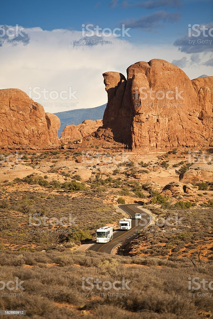 RV drives in the canyon royalty-free stock photo