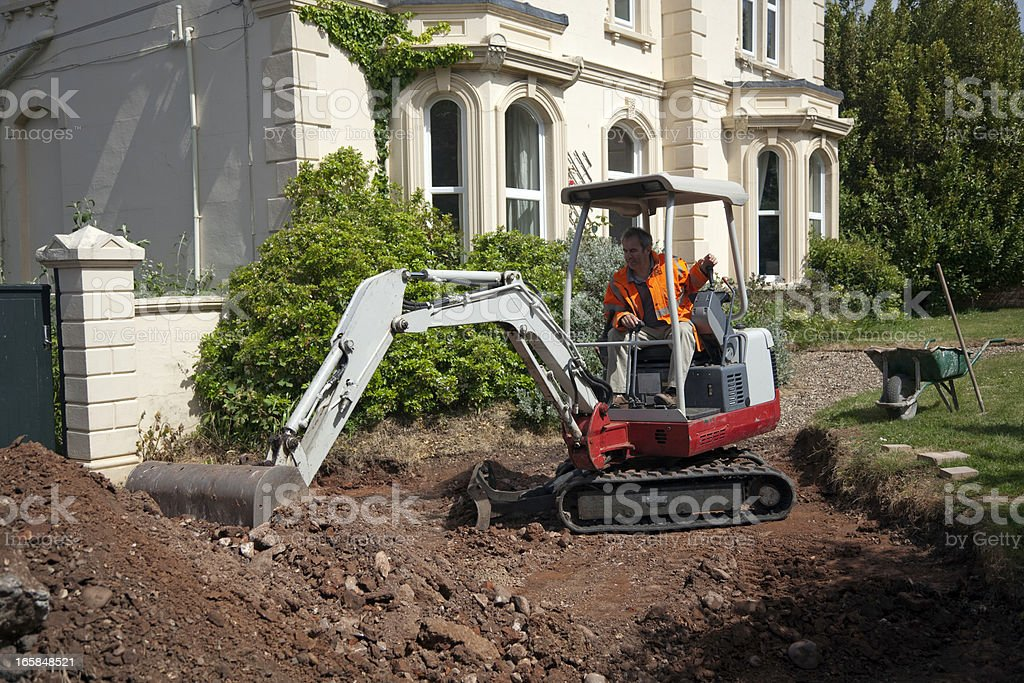 Driveway Construction: Preparing the ground royalty-free stock photo