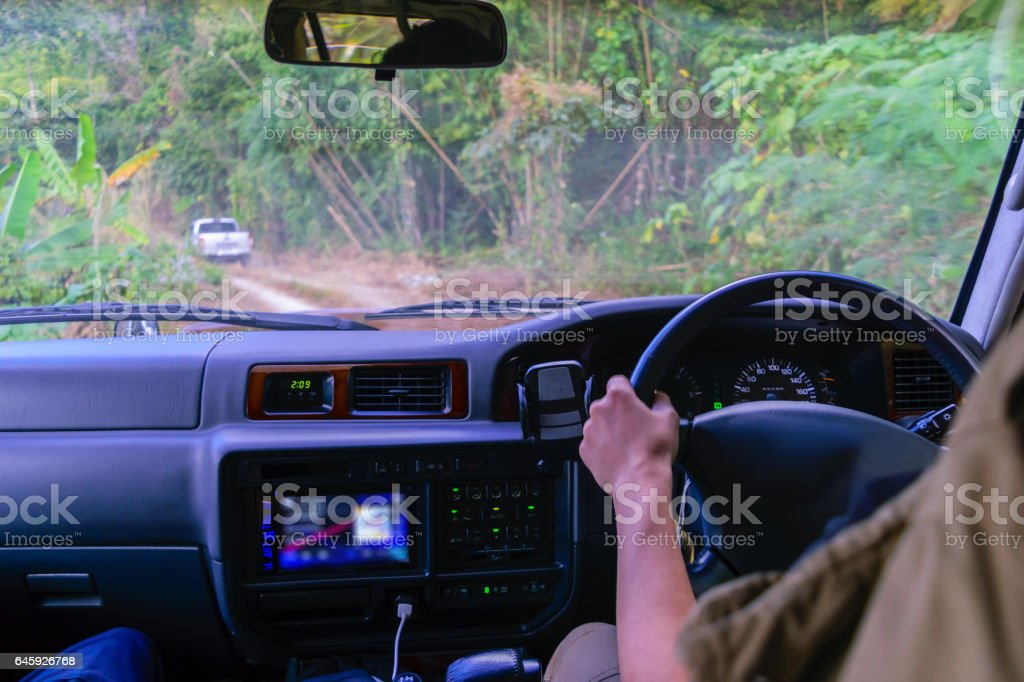 Driving 4wd off road in tropical forest. stock photo