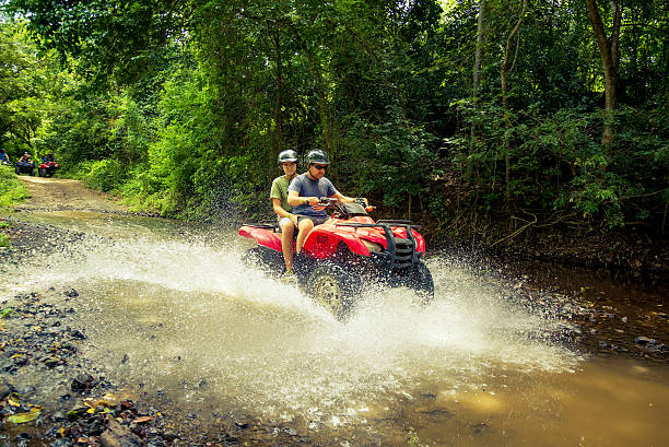 driving 4x4 in costa rica driving four wheelers (atv) in costa rica quadbike stock pictures, royalty-free photos & images