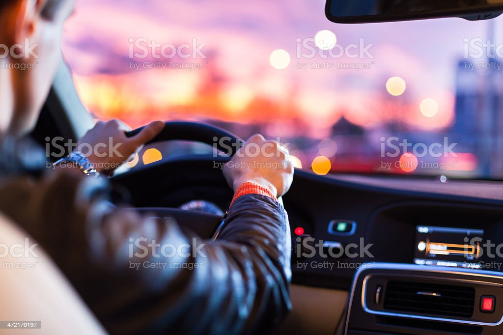 Driving a car at night stock photo