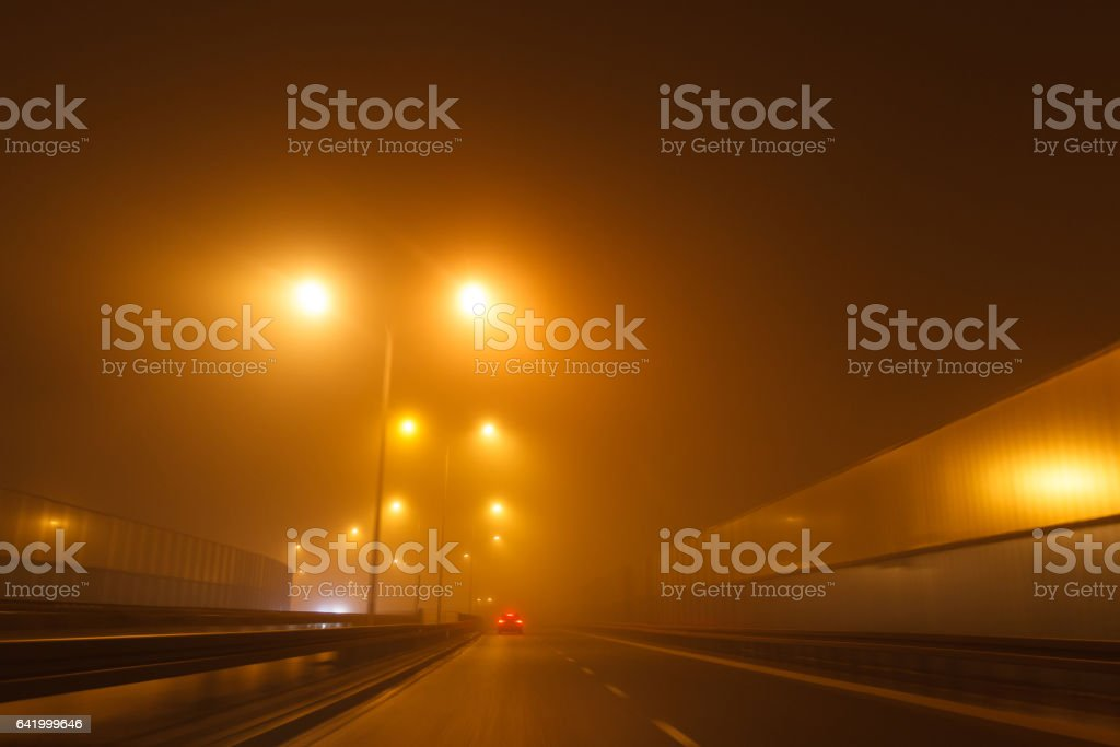 Driving a car in bad weather conditions stock photo